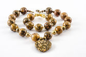 Jasper leopard skin necklace and bracelet — Stock Photo