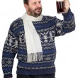 Bearded man in sweater is keeping ale pint — Stockfoto