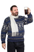 Bearded man in sweater is keeping ale pint — Stock Photo