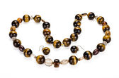 Tiger eye collar with earrings — Stock Photo