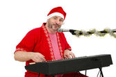 Santa plays and sings on electric piano — Stock Photo