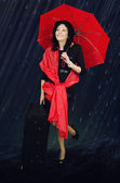 Woman stands under rain — Foto Stock