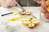 Measuring the diameter of the rotten apple — Stock Photo