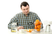 Phytocontrol technician inspects the appearance of mandarine — Stock Photo