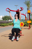 Woman exercising on Lat Pull outdoor machine — Stock Photo