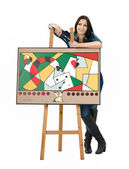 Artist leaning on an easel with her abstract painting — Stock Photo