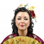 Close up portrait of a stylized kimono woman with fan — Stock Photo #48152347