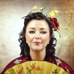 Face portrait of a stylized kimono woman with fan — Stock Photo #48152415