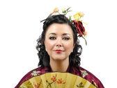 Close up portrait of a stylized kimono woman with fan — Stock Photo
