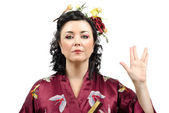 Kimono woman showing Vulcan salute — Stock Photo
