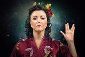 Kimono woman showing Spoke sign — Stock Photo