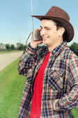 Cowboy man enjoying funny radio — Stock Photo