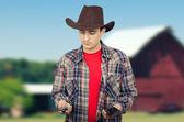 Cowboy deciding whom to call him — Stock Photo