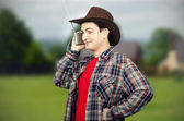 Farmer getting tuned on western music — Stock Photo