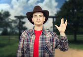 Paleface young cowboy showing Spoke sign — Stock Photo