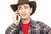Portrait of young cowboy with ironic smile — Stock Photo