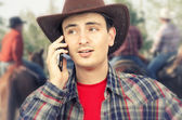 Ironic little smile of cowboy lips calling on phone — Stock Photo