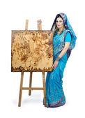 Woman in Indian turquoise sari with pyrography painting — Stock Photo
