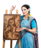 Artist showing pyrography painting Prosperity on the easel — Stock Photo