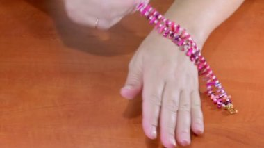 Wearing magenta MOP sticks bracelet — Stock Video