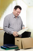 Happy 50y. o. man working in new department — Stock Photo