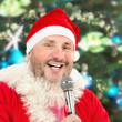 Cheerful Santa singing with microphone — Stock Photo #49357515