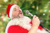 Huge Santa Claus belting Ho-ho-ho — Stock Photo