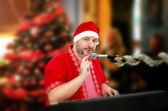 Santa Claus tapping microphone — Stockfoto