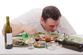 Hangover among leftovers — Stock Photo