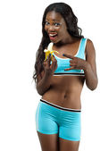 Girl on diet holding banana — Stock Photo