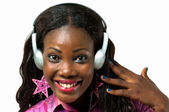 Smiling African American woman listening to music with headphone — Stock Photo