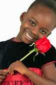 Beautiful little girl with red rose — Stock Photo