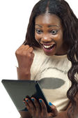 Pretty African American woman happy using a tablet pc — Stock Photo
