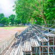 Green grandstand under the tree — Stock Photo