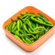 Green Chilli Peppers in box isolated on white — Stock Photo