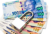 Close up of lock and money, isolated on the white — Stock Photo
