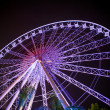 Ferris wheel  in motion at amusement park — ストック写真