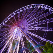 Stock Photo: Ferris wheel and rollercoaster in motion at amusement park