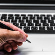Young business hand writing in a laptop — Foto Stock