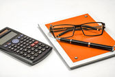 Blank notepad and accessories for secretary in the office, calcu — Stock Photo