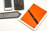 Blank notepad and accessories for business people — Stock Photo