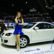Stock Photo: Unidentified modellings posted over new Proton gen 2 display on stage