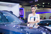 Unidentified modelling posted with BMW X6 M 50d — Stock Photo