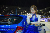 Unidentified modellings posted over The new Proton Suprima S display on stage — Stock Photo