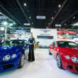Постер, плакат: Unidentified modellings posted over Bentley Continental GT V8 and Bentley GT