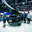 Постер, плакат: Unidentified people look at Nissan Juke display on stage