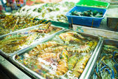 Fresh lobsters on ice for sale at restaurant. — Stock Photo
