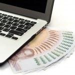Laptop keyboard and money — Stock Photo #42399971