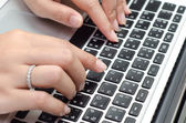 Typing on keyboard. female finger — Stock Photo