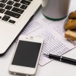 Laptop with cellphone , book bank, cookie, bread and cup of coff — Stock Photo #43042735